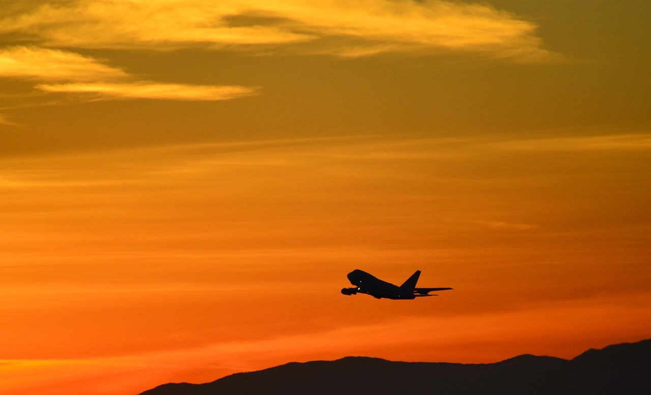 plane in the sunset